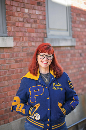 Carrie Brocksmith is seen here wearing her letter jacket, something she hasn't been able to do  in a long time.